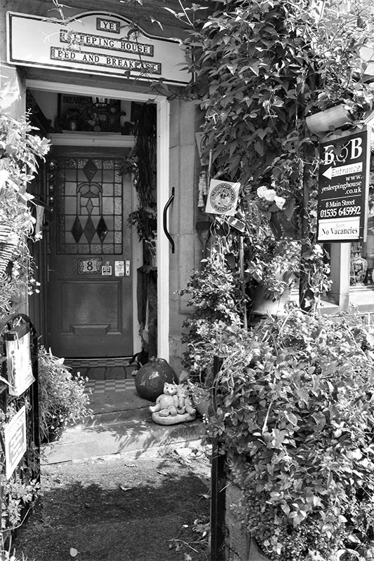 Black and white photo of Ye Sleeping House Bed and Breakfast in Haworth